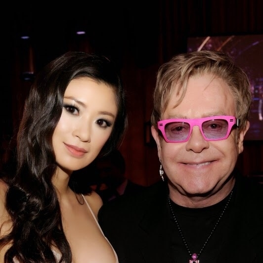 Rebecca Wang and Elton John at Academy Awards viewing party on Oscars night.
